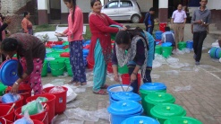 More than 50 people volunteered to help MCC Nepal's partner RICOD with relief efforts, including those pictured here packing relief kits at a community college in Kathmandu. The kits were then sent to earthquake-affected families in remote villages in southern Lalitpur district. RICOD, with support from MCC, runs a mother and child nutrition program in this area. (Photo courtesy of RICOD staff)