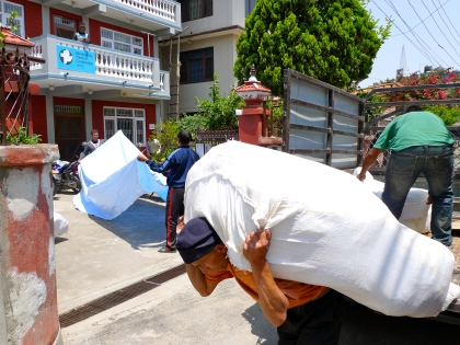 After many hours in the back of a truck, tarps from southern Nepal arrive at the MCC office in Kathmandu. From here, they will be transported another 100 miles to Okhaldhunga district in eastern Nepal. (MCC photo/Katrina Labun)