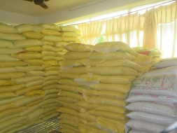 Sacks of chiura, ready-to-eat beaten rice, are stacked to the ceiling in the office of MCC's partner, Shanti Nepal. This food is part of MCC Nepal's emergency food relief work in the community of Darkha in northern Dhading district. (Photo courtesy of Shanti Nepal staff)