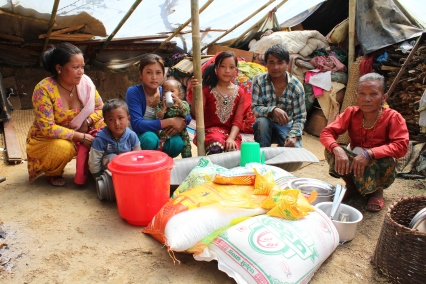 Anita Lama, 71, (right), and her family received food and sleeping mats from MCC through our partner RICOD. After the earthquake destroyed two of the extended family's houses in south Lalitpur, they were forced to sleep under tarps on the ground. Though they had food stored in their ruined houses, they were only able to retrieve a small amount of it. MCC and RIOCD also provided the family with a three-week supply of food (rice, lentils and oil). (MCC photo/Binod Deshar)