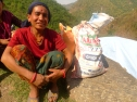 Burnamay Khatri, 28, mother of three children, received food from MCC through one of its local partners, Group of Helping Hands, in Okhaldhunga District, Nepal. Khatri's home was destroyed after the earthquake. (MCC photo/Durga Sunchiuri)