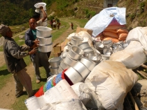 Tej Kumar Rai, a SAHAS project officer in Okhaldhunga, helps unload relief materials in Ragani, Okhaldhunga. (MCC photo/Durga Sunchiuri)