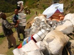 Tej Kumar Rai, a SAHAS project officer in Okhaldhunga, helps unload relief materials in Ragani, Okhaldhunga. (MCC photo/Durga Sunchiuri)