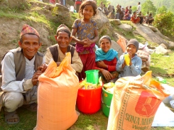 Earthquake-affected families in Ragani, Okhaldhunga pose with their relief items. (MCC photo/Durga Sunchiuri)