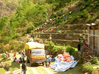 After ten gruelling hours of travel, this truck carrying MCC supplies could go no further. From here, residents of Ragani village carried their relief supplies home over steep and rugged terrain. (MCC Photo/Durga Sunchiuri)