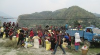 Residents of Darkha, in northern Dhading district, gather to collect relief supplies from MCC's partner Shanti Nepal. This area was highly affected by the earthquake, and many people lost their stored food when their homes collapsed. All 1,300 households in Darkha received a 2-week supply of beaten rice, roasted peanuts and lentils, and instant noodles. The road only reaches the border of the district, so residents of remote communities had to walk in and carry their supplies home - a walking distance of up to several hours over hilly trails. (Photo courtesy of Shanti Nepal staff)