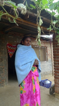 Mina Bediya stands in front of her house, rebuilt with support from MCC following a devastating fire in 2012. She is the chairperson of the Ramwapur community organization and a board member of Janajagarun Samaj. She was part of spearheading efforts to collect food for earthquake affected areas of Nepal in April 2015.