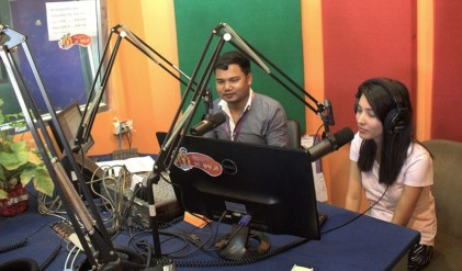 Hosting radio program with co-worker Sopheak Chum